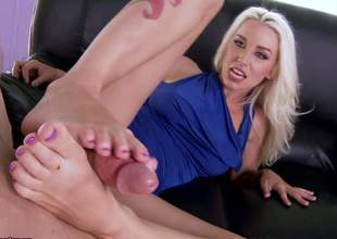This blonde has legs that go on for forever. She's going to use them feet to make his cock real wonderful and hard, so a footsie is just the thing for this mo fo