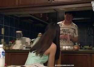 Breasty oriental kitchen tit fuck