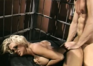 Alex Sanders pounds the stacked blonde's fiery snatch in a prison apartment
