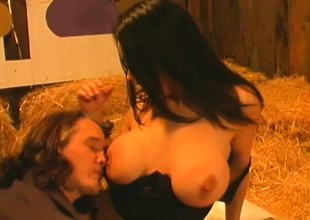 Buxom Angelica Sin has a guy satisfying her sexual needs in the barn
