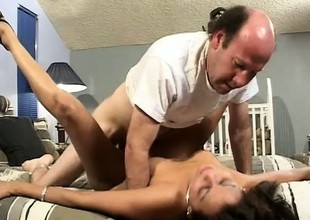 Striking ebony sweetheart Natalie gets fucked by a horny granddad on the bed