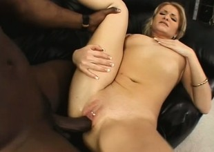 Dazzling golden-haired fully enjoys her first encounter with a large swarthy dick