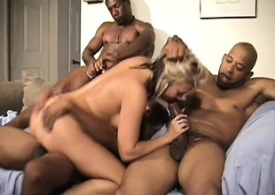 Luscious golden-haired cougar has a bunch of black guys banging all her holes