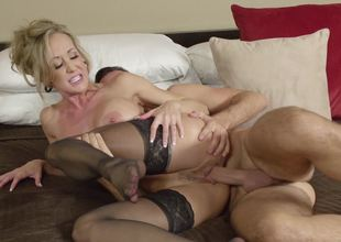 Sexy cougar is getting a dick in her juicy cunt on the bed
