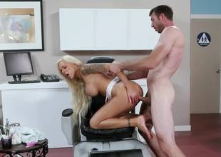 A blonde that has huge tits is getting her pussy stretched