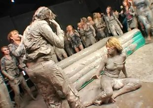 Gorgeous and adventurous amateur women wrestling in the mud
