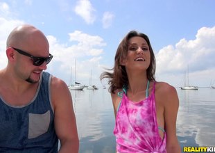 During a boating trip this skinny bikini beauty gets a-hole fucked