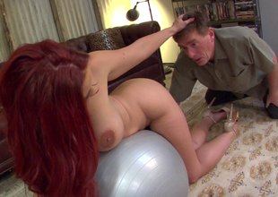 A curvy, sexy redhead backs that big ass up onto a cock