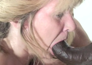 Kinky mama munching on a bunch of black rods
