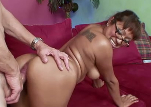 Mesmerizing milf in glasses rides a large white dick on the embed