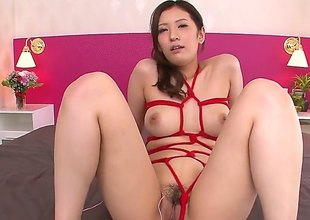 This Japanese hot chick with a nice ass is having her pussy taken care of handy first by a vibrator. She has her pussy nice and ready for a nice and hard dick