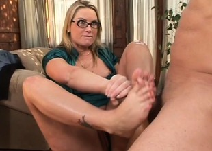 Spectacled blonde teases her incredible body in a foot fetish scene