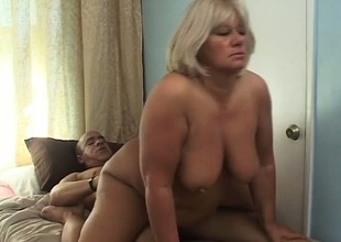 Chunky aged blonde has a hung black stud fulfilling her raunchy needs