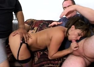 Nasty blonde milf with big boobs gets fucked in both holes by two guys