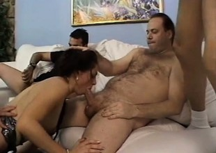 Filthy young hottie moans with excitement as she pleases a group of guys