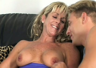 One penis isn't enough for such a horny MILF, this babe needs two of 'em