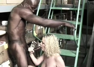 Pretty juvenile golden-haired gets pounded by two black studs in the warehouse